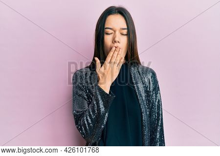 Young hispanic girl wearing party jacket bored yawning tired covering mouth with hand. restless and sleepiness.