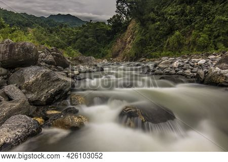 River Descending From The Mountains Between The Rocks In Tucumán Province, Argentina  Smooth Waters