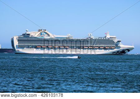 July 6, 2021 In Long Beach, Ca:  Jet Skiing Riding Besides A Contemporary Cruise Ship Taken In The L