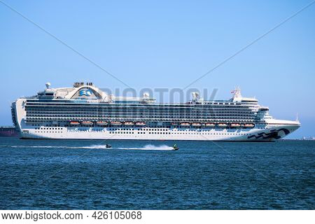 July 6, 2021 In Long Beach, Ca:  People Jet Skiing Besides A Princess Cruise Ship Anchored In The Lo