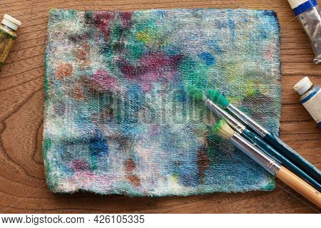 Oil painting preparation. Painters cloth and painting brushes on a old painters desk.