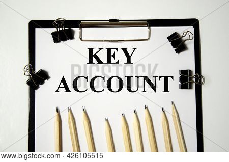 Key Account The Word Is Written On A White Piece Of Paper With Pencils