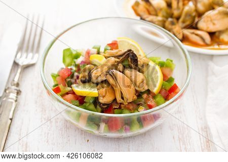 Salad With Seafood Mussels In Dish And Fork