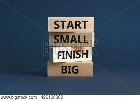 Start Small Finish Big Symbol. Concept Words 'start Small Finish Big' On Wooden Blocks On A Beautifu