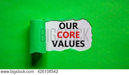 Our Core Values Symbol. Words 'our Core Values' Appearing Behind Torn Green Paper. Beautiful Green B