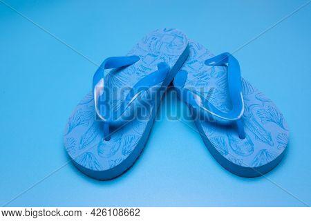 Blue Flip Flops On A Blue Background