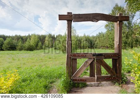 Wooden Closed Gates To The Meadow, The Passage Is Closed