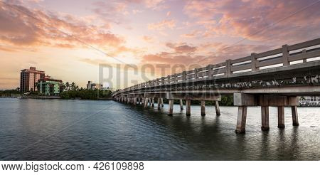 Sunset Sky Over Bridge Over Hickory Pass Leading To The Ocean In Bonita Springs, Florida.