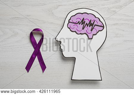 Human Head Cutout With Brain, Pulse Line And Purple Ribbon On White Wooden Background, Flat Lay. Epi