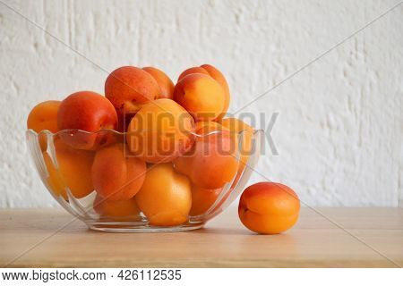Fresh Ripe Apricots In Transparent Glass Bowl