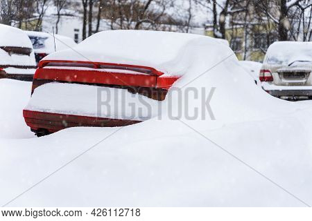 Winter, Snowdrifts, Passenger Car On Parking Yard, Covered With Snow. Weather Concept