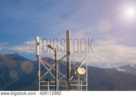 Telecommunications Transmitters 4g, 5g. Cellular Base Station With Transmitter Antennas Near The Roa