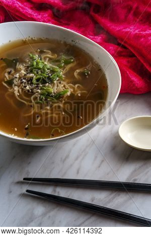 Japanese Miso Ramen Noodle Soup With Tuxedo Sesame Seeds And Sliced Scallions For Garnish