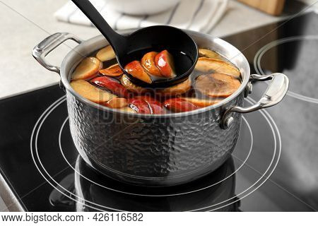 Preparing Delicious Compot From Apple Slices On Stove