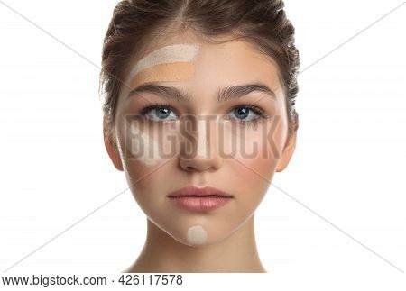 Beautiful Girl On White Background. Using Concealer And Foundation For Face Contouring
