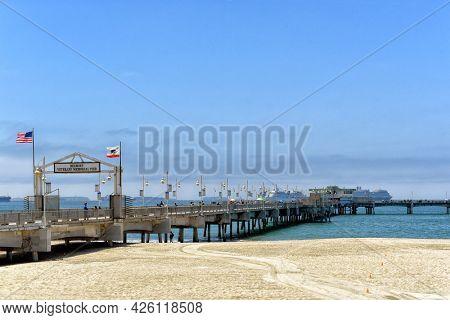 LONG BEACH, CALIFORNIA - 5 JULY 2021: The Belmont Veterans Memorial Pier seen from Shoreline Way.