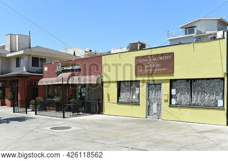 LONG BEACH, CALIFORNIA - 5 JULY 2021: The Cyprus Persian Grill and Primal Alchemy Catering restaurants in the Belmont Shores neighborhood.
