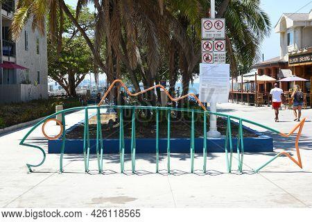 LONG BEACH, CALIFORNIA - 5 JULY 2021: Fish shape bicycle rack in the Belmont Shores neighborhood near the Belmont Pier.