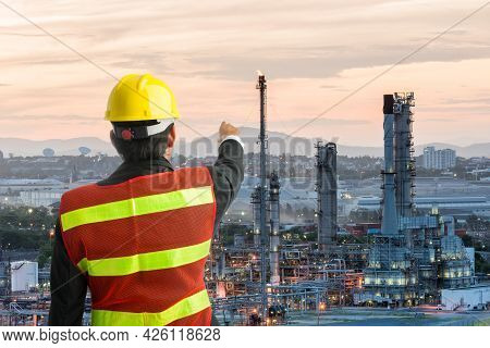Petrochemical Engineering Man With White Safety Helmet Standing In Oil Refinery Building Structure P