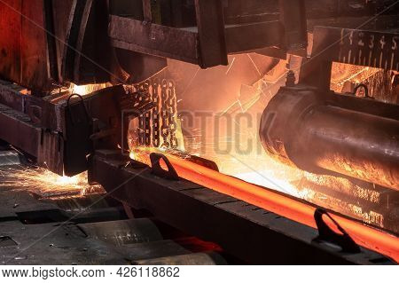 The Process Of Cutting Hot Rolled Steel Into Lengths.