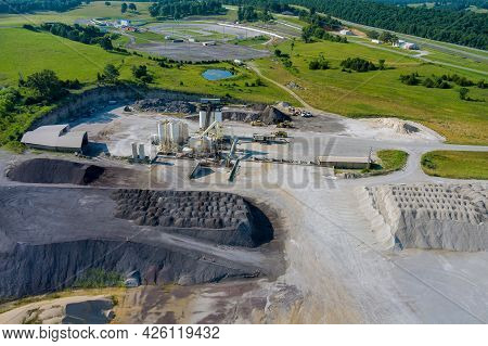 Aerial View Of Opencast Mining Quarry With Of Machinery At Work Quarries Stones Scattering On The Wo