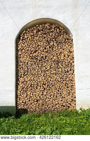 A Pile Of Dry Birch Firewood In The Wall Of The Spaso-yakovlevsky Monastery In The City Of Rostov, Y