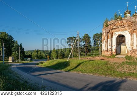 Highway Winding Road In The Rays Of The Setting Sun In The Village Of Stromikhino, Ivanovo Region, R