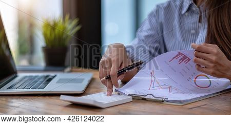 Woman Investment Consultant Analyzing Company Annual Financial Report Balance Sheet Statement Workin