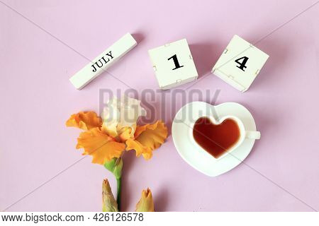 Calendar For July 14 : The Name Of The Month Of July In English, Cubes With The Number 14, A Cup Of