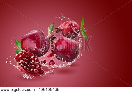 Ripe Pomegranate Fruit On A Red Background.