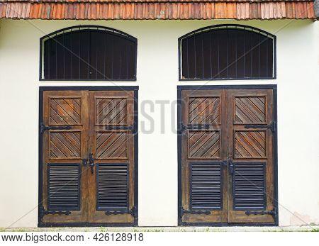 Two Symmetrical Wooden Entrance Doors. Symmetrical Architecture Elements.