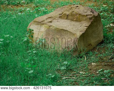 Stone Piece Of Rock Mountain Presented At Green Grass Asian Park Field.