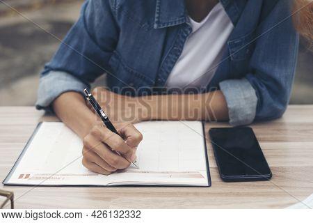 Planner Plan Schedule Calendar And Reminder Agenda, Work Online At Home. Women Hand Planning Daily A