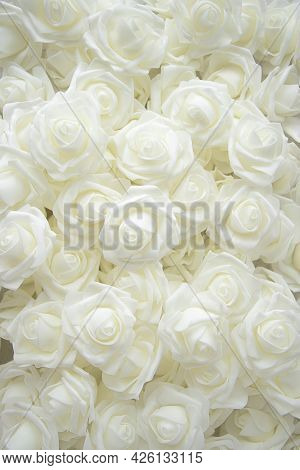 Background Of Many Fake White Roses. Top View. Flat Lay
