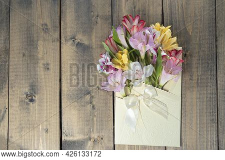 Multicolored Flowers In Envelope With Copy Space. Multicolored Alstroemerias, Pink, Yellow, Purple,