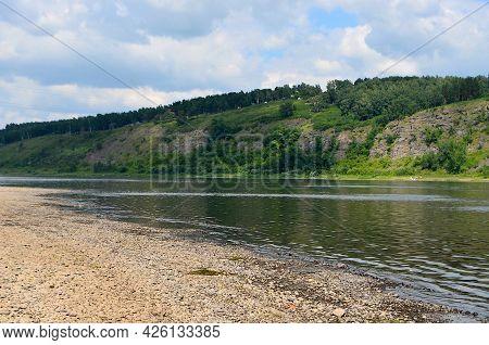 Siberian Landscape - Rocky River Bank, Mountainous Terrain, Green Trees.