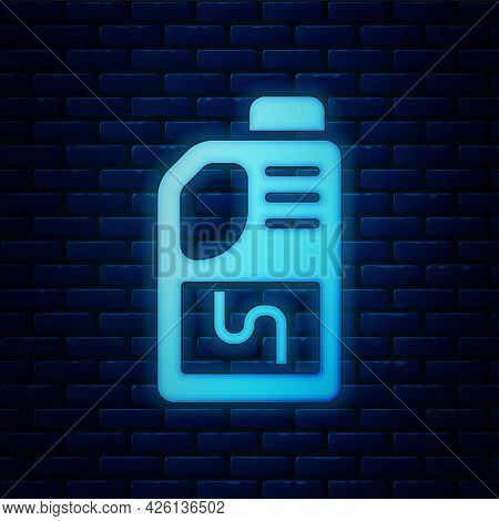 Glowing Neon Drain Cleaner Bottle Icon Isolated On Brick Wall Background. Water Pipes Cleaning. Plum