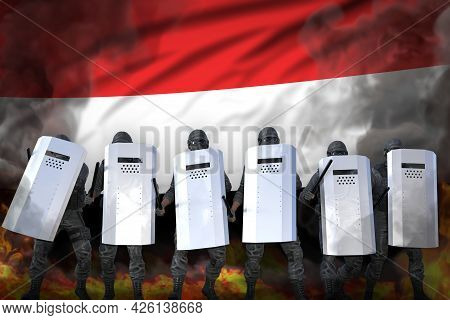 Yemen Protest Fighting Concept, Police Guards In Heavy Smoke And Fire Protecting Order Against Revol