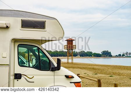 Camper Car On Quitapellejos Beach, Andalucia Region In Spain. Traveling And Adventure In Motorhome.