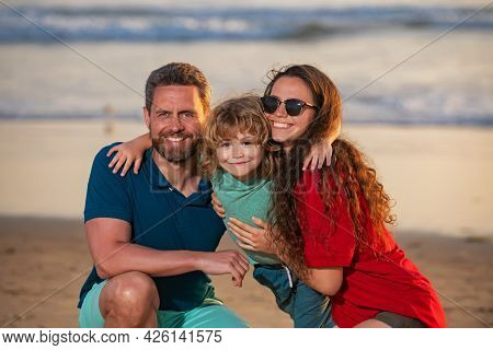 Father And Children Playing On The Beach. Concept Of Friendly Family. Family Hugging Outdoor.