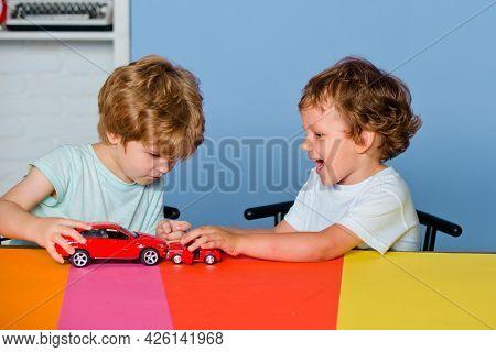 Children Playing With Toy Car At Kindergarten. Children Pupils From Elementary School. Caucasian Kid