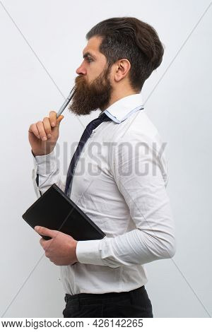 Business Man With Pen In His Mouth. Male With Notepad For Writing. Businessman Holds Notepad And Pen