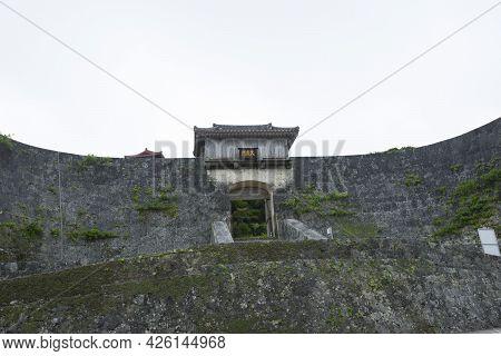 Kyukeimon Gate At Shuri Castle In Okinawa. Japanese Kanji Characters Translate As \