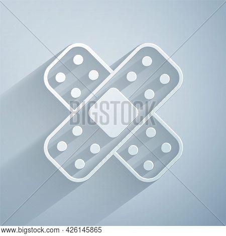 Paper Cut Crossed Bandage Plaster Icon Isolated On Grey Background. Medical Plaster, Adhesive Bandag