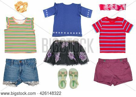 Collage Set Of Little Girls Summer Clothes Isolated On A White Background. The Collection Consists O