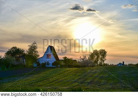 Country House In The Countryside. Fields And Farm Buildings In The Distance With Trees And With A Dr