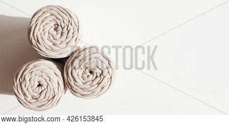 Handmade Macrame Braiding And Cotton Threads On White Background. Hobby Knitting Cotton Yarn Reel. N
