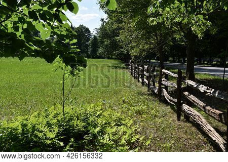 Fence On A Countryside Landscape With Farm In Quebec, Canada