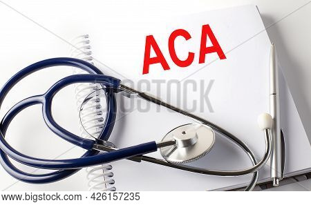 Notebook With Text Aca Affordable Care Act With Pen And Stethoscope