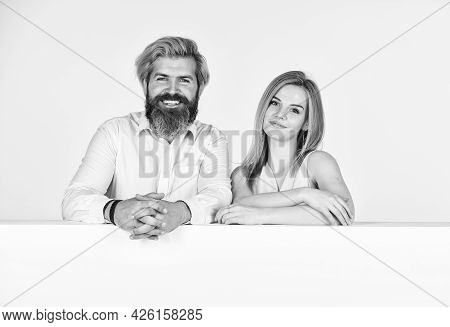 Happy Couple In Studio. Young Family Portrait. Bearded Man And Woman. Smiling Girl Has Blonde Hair.